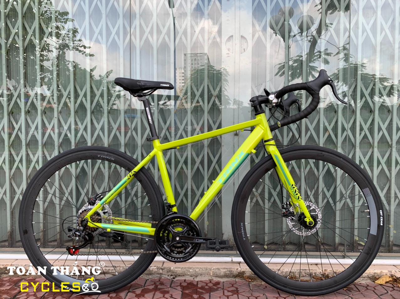 Xe đạp đua TrinX Tempo 1.1 Dics 2020 Vàng chanh